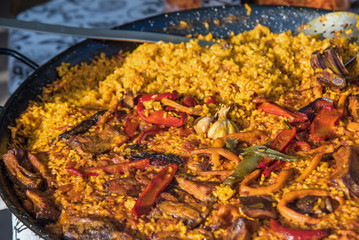 Typical spanish paella in the big traditional pan. Close view. Selective focus2