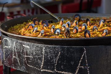 Typical spanish seafood paella in traditional pan close view. Selective focus2