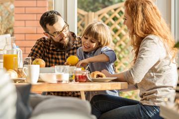 Lovely family eating breakfast