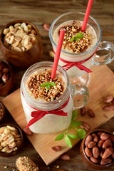 Protein cocktail with peanuts in a glass jar