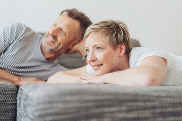 Attractive middle-aged couple watching TV