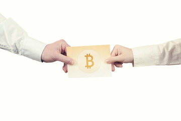 Two hands with paper banknote of cryptocurrency bitcoin. Symbol BTC. Bitcoin bifurcation