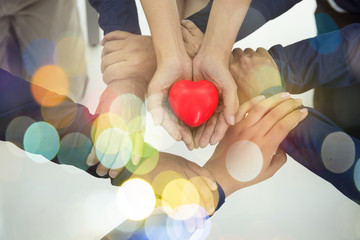Group of hands holding red heart, health care, love, organ donation, family insurance and CSR concept