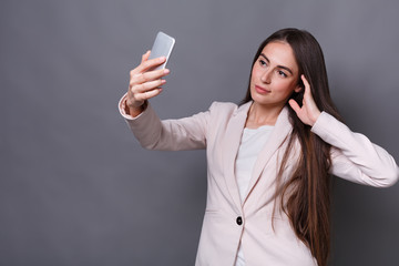Business woman taking selfie with phone