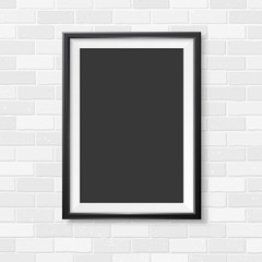 Photoframe vertical realistic mock up on brick wall black 1