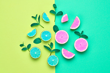 Pink Citrus Fresh Fruit with Mint leaves. Vegan Organic Food Concept. Creative Layout. Flat lay. Trendy fashion Style. Minimal Design Art. Hot Summer Vibes. Bright Color.