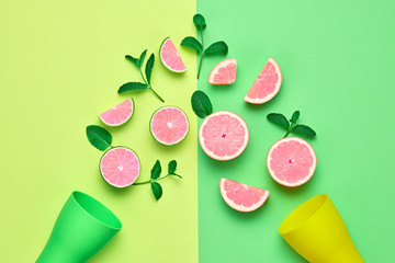 Citrus Fresh Fruit with Mint leaves. Vegan juice Organic Food Concept. Creative Pink Blue Layout. Flat lay. Trendy fashion Style. Minimal Design Art. Summer Bright Neon Color.