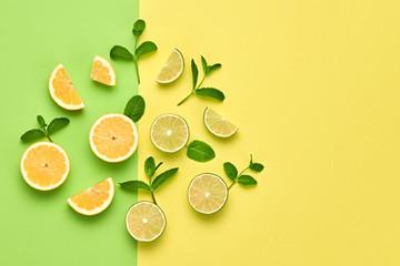 Vegan Organic Food Concept. Orange Citrus Lemon Fresh Fruit with Mint leaves. Creative Layout. Flat lay. Trendy fashion Style. Minimal Design Art. Hot Summer Vibes. Bright Color.