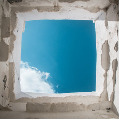 White window to the blue sky in Andros, Cyclades, Greece