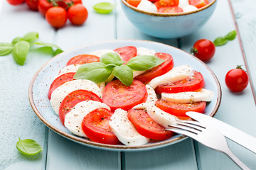 Classic caprese salad. Mozzarella tomatoes and  Basilikum.