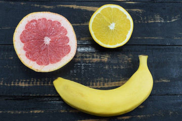 orange, grapefruit and banana on the table, a symbol of diet and healthy eating