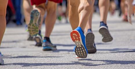 runnesr feet back race on asphalt action