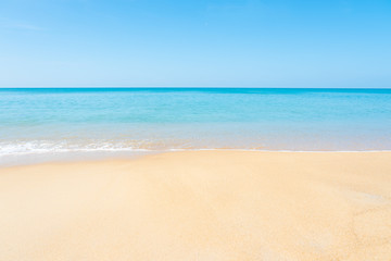 Beautiful sandy beach and tropical sea with blue sky in summer day.