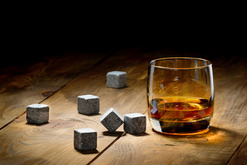 Wall Mural - Whiskey and whiskey stones on a wooden table.