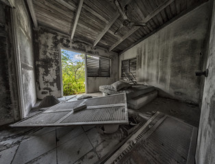 The derelict bedroom of an apartment after a volcanic eruption