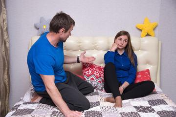 Portrait of the father and daughter during family relationships, problems, conflict in the room.