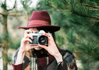 Woman taking a photo with a vintage camera
