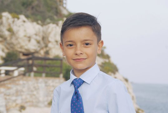 Portrait of a smiling boy wearing a shirt and tie, Malaga, Andalucia, Spain