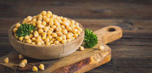 Fresh chickpeas in wooden bowl