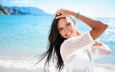Beautiful Smiling Woman on Beach