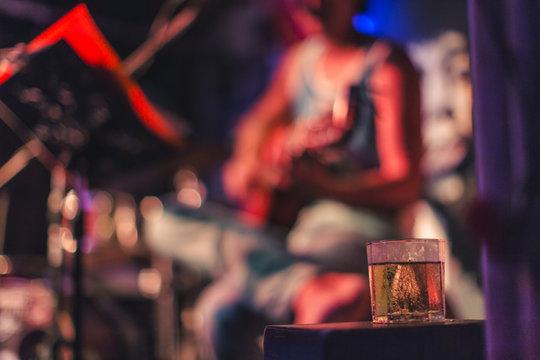 alcohol, bokeh background singer in bar