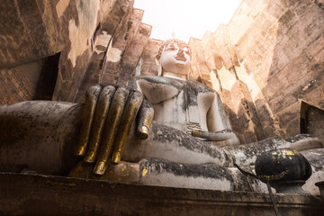 Big Ancient Buddha statue is sitting, beautiful. And is very respectful of wat wi whum temple in the sukhothai historical park area.a UNESCO world heritage site ,Sukhothai, Thailand