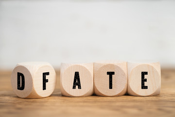 Cubes with letters show, that FATE and DATE could be very close together