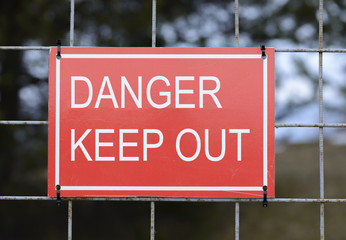 """It is a closed territory with a red sign warning """"keep out"""". The protected object with a cautionary visual symbol is in unpopulated zone."""