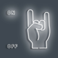 Neon sign hand that rocks finger.White sign on a Gray