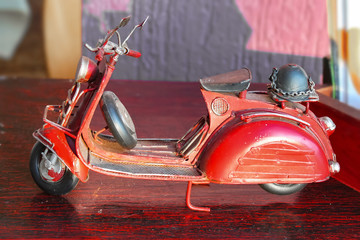 Antique miniature red toy diecast tricycle scooter with German helmet on back