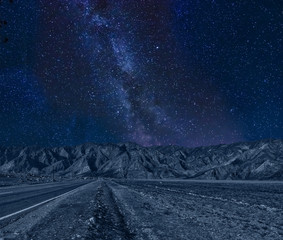 Picturesque night mountains landscape with Milky Way on starry sky