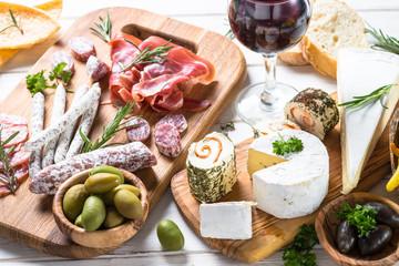 Antipasto delicatessen - meat, cheese and wine.