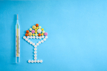 Pills and tablets, the concept of health disorders-a symbol of poor health on a blue background