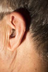 Deaf man hearing aid ear