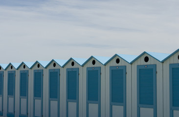 wooden beach cabins by the sea, changing rooms, blue and white, used to change and put on bathing suit, vacation, summer, sun, ligurian riviera, Albenga beach, Italy