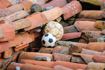 Soccer balls lost on the roof