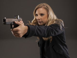 Woman aiming her gun.