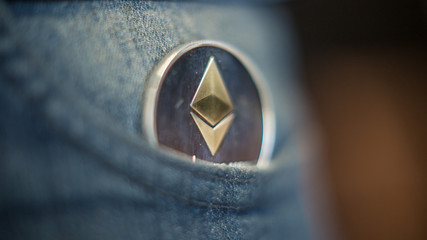 Metal Ethereum coins in in the pants pocket. Ethereum - modern virtual