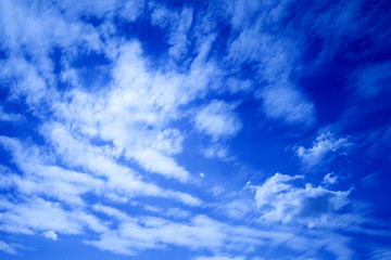 Bright blue sky and white clouds.