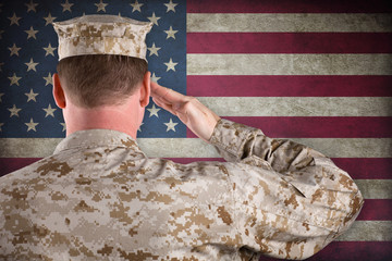 Marine In Desert Uniform Saluting In Front of American Flag
