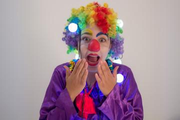 Portrait of happy funny clown girl