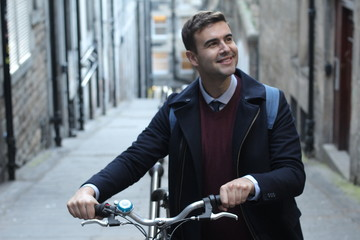 Smiley student heading to campus by bicycle