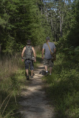 Two Male Hikers Going Into National Forest