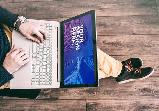 Laptop User with Crossed Legs Mockup