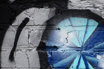 Street art. Abstract background image of a fragment of a colored graffiti painting in chrome and...