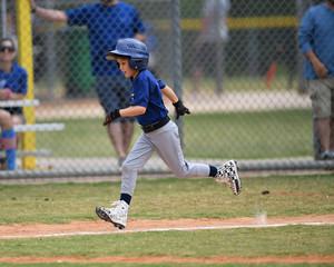 Young Boy Playing Little League Baseball