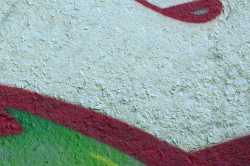 Street art. Abstract background image of a fragment of a colored graffiti painting in chrome and red tones