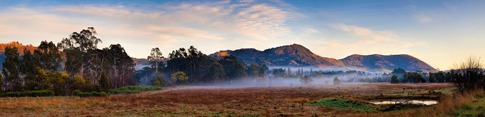 Tuinposter Diepbruine Panoramic view of alpine region near Mt Macedon, Victoria, Australia on an autumn morning