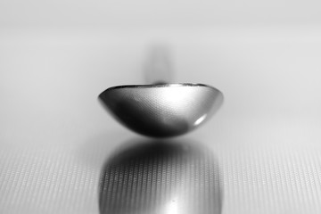 Extreme close up shot of spoon on metallic background