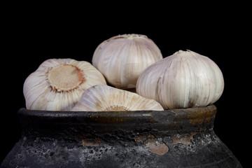 Garlic in a clay pot